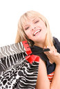 Shopper happy woman with shopping bags over white Royalty Free Stock Images