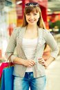 Shopper in the mall pretty lady with colorful shopping bags looking at camera Royalty Free Stock Photo
