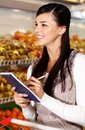 Shopper in supermarket Royalty Free Stock Image