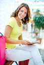 Shopper with touchpad vertical portrait of an attractive woman shopping Royalty Free Stock Photos