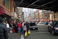 Shoppers in chinatown new york usa looking west down east broadway where manhattan bridge passes over it and market street crosses Stock Images