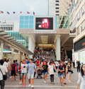 Shoppers outside Harbour City, a shopping mall in Royalty Free Stock Photo