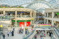 Shoppers at a shopping centre leeds uk september trinity housed under giant iconic glass roof trinity leeds is located in the Royalty Free Stock Photos