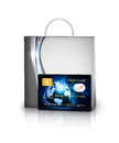 Shopping bag and credit card isolated over white background Stock Photography