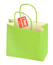 Shopping bag and guarantee tag isolated on white background Royalty Free Stock Photo