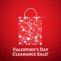 Shopping bag for valentines day made of hearts on red striped background Royalty Free Stock Image