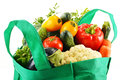 Shopping bag with variety of fresh organic vegetables isolated on white background Stock Photography
