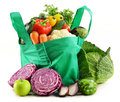Shopping bag with variety of fresh organic vegetables on white Royalty Free Stock Photos