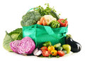 Shopping bag with variety of fresh organic vegetables on white background Royalty Free Stock Photos