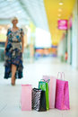 Shopping bags in front of woman Royalty Free Stock Image
