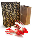 Shopping bags with ladies shoes Stock Photos