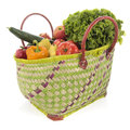 Shopping basket with vegetables and fruit