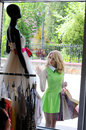Shopping beautiful blonde looks on mannequins of the show window Royalty Free Stock Photo