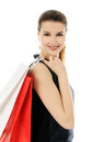 Shopping beautiful cheerful girl with bags Royalty Free Stock Image