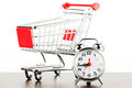 Shopping cart and alarm clock Stock Photography