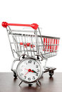 Shopping cart and alarm clock Royalty Free Stock Images