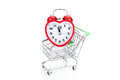 Shopping cart with alarm clock in shape of a heart Royalty Free Stock Photo