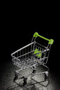 Shopping cart on a black background Royalty Free Stock Photo