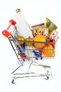 Shopping cart with Christmas gifts Stock Photo