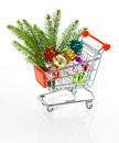 Shopping cart with christmas tree decoration Stock Photos