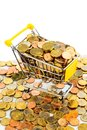 Shopping cart with coins a is well stocked euro symbolic photo for purchasing power and consumption Royalty Free Stock Photography