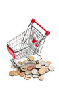 Shopping cart with dollar coins on white background Royalty Free Stock Image