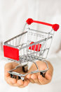 Shopping cart empty in hands Stock Photos