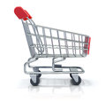 Shopping cart empty over white reflective background Royalty Free Stock Images