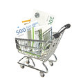 Shopping cart filled with danish bills in different values Stock Image
