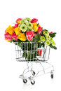 Shopping cart with flowers roses and chrysanthemum Royalty Free Stock Images