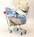 Shopping cart full of crumpled euro money Royalty Free Stock Photo