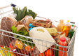 Shopping cart full dairy grocery Royalty Free Stock Photo