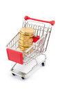 Shopping cart full ofcoin shape chocolates white background Royalty Free Stock Photo