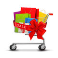 Shopping cart full of shopping bags and a gift bow Stock Images
