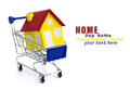 Shopping cart with house and buying homes as a real estate market symbol a shop Stock Photography
