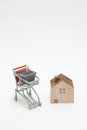 Shopping cart and house on white background. Buying new house, Royalty Free Stock Photo