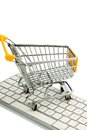 Shopping cart keyboard is on the of a pc symbolic photo for online and consumer behavior Stock Photo