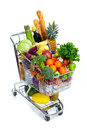 Shopping cart metal with grocery items isolated over white background Stock Images