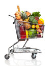 Shopping cart metal with grocery items isolated over white background Royalty Free Stock Photography