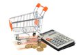 Shopping cart money and calculator isolated on white background Royalty Free Stock Image