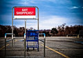 Shopping cart in parking lot Stock Photo