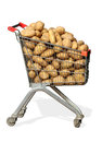 Shopping cart with potatoes on white background Royalty Free Stock Photography