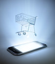 Shopping cart on a smart phone mobile commerce concept Stock Images