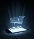 Shopping cart on a smart phone mobile commerce concept Royalty Free Stock Photos