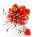 Shopping cart strawberries Stock Images