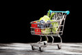 Shopping cart with vegetables on black background Royalty Free Stock Photo