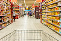 Shopping cart view on supermarket aisle bucharest romania july of people in store Stock Image