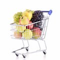 Shopping carte with fruits cart on white Stock Photo