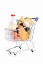 Shopping carte with groceries cart dairy product isolated on white Stock Photography