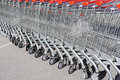 Shopping carts in rows a string of outdoors Royalty Free Stock Photos